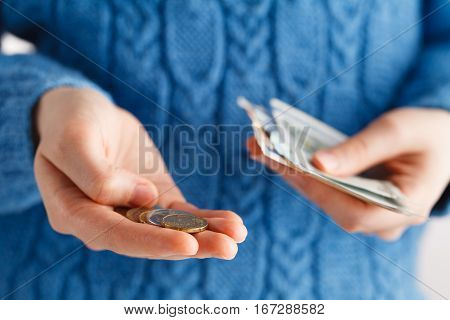 Young Woman Consider Money