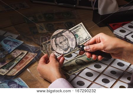Five Dollars In The Woman's Hand, Through A Magnifying Glass