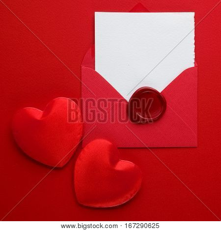 Envelope Mail, Red Heart and wax seal on red Background. Valentine Day Card, Love or Wedding Greeting Concept