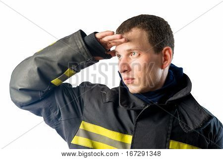 Fireman in protective suit looks off into the distance on a white background