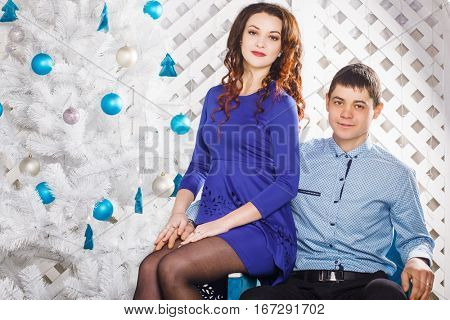 beautiful couple in love on a blue background Christmas