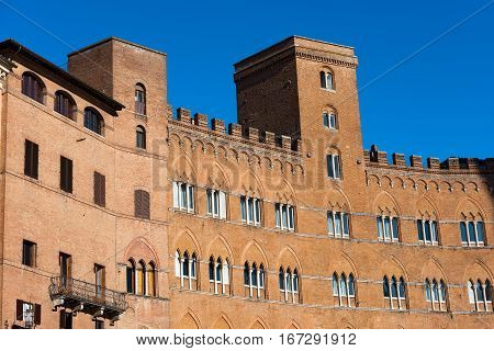 Detail of ancient palaces in the medieval Piazza del Campo (Campo square) in the downtown of Siena Toscana (Tuscany) Italy