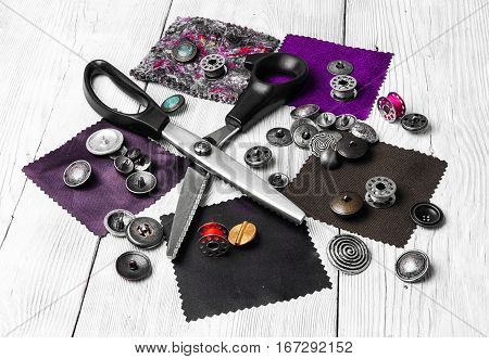sewing kit made of fabricscissorsbuttons and spools