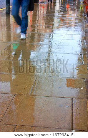 man wearing jeans and trainers in the rain, depression and anxiety