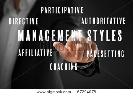 Management styles concept. Businessman working with virtual screen