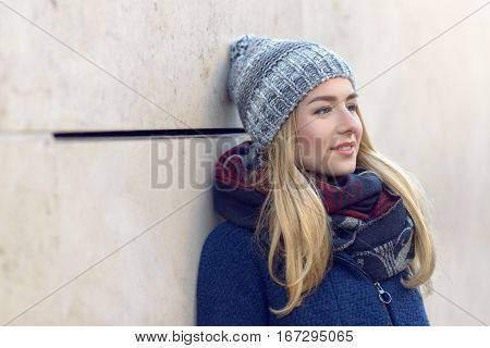 Thoughtful Young Woman Standing Daydreaming