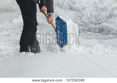 Business Man With Shovel Cleaning Snow Filled Street In Front Of The Office At Work