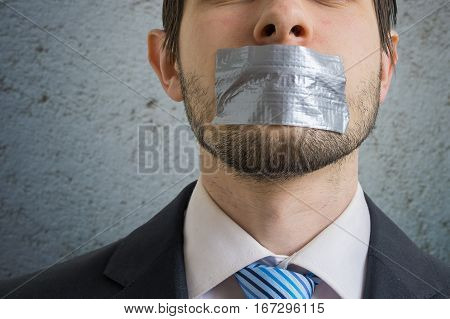Censorship Concept. Man Is Silenced With Adhesive Tape On His Mo