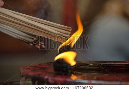 Burning the joss stick in chinese temple.