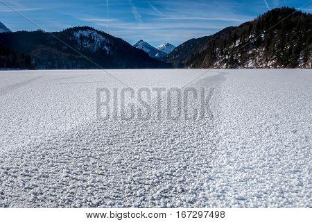 View over frozen Alpine Lake below Hohenschwangau