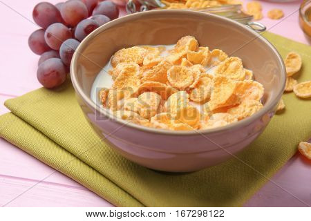 Tasty cornflakes on pink background