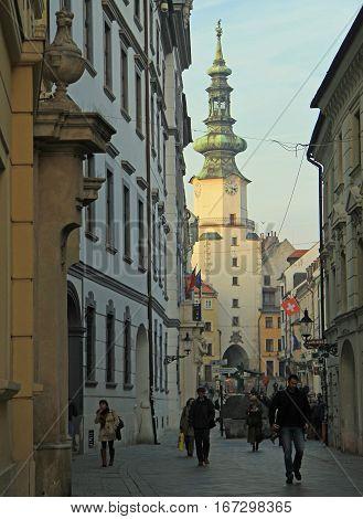 Bratislava, Slovakia - November 4, 2015: people are walking by the narrow street in Bratislava, Slovakia