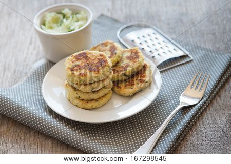 Paleo style zucchini fritters made with coconut flour selective focus