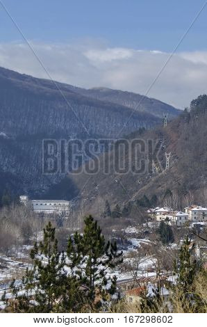 Residential district of bulgarian houses in winter village Pasarel with Hydro-Electric power station, Bulgaria
