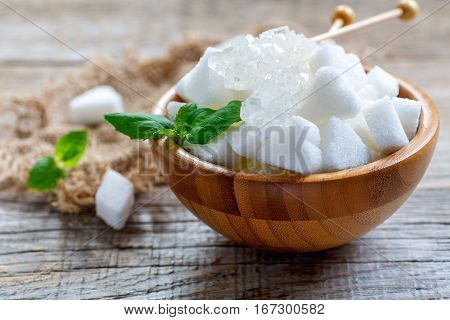 White Figured Sugar And Crystal Sugar Sticks In A Wooden Bowl.