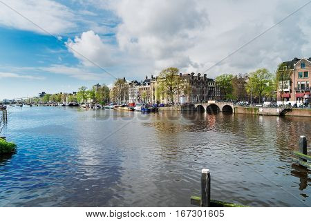 embankment of Amstel canal water in Amsterdam, Netherlands