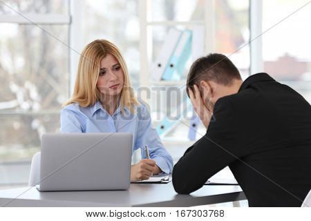 Job interview concept. Human resources manager interviewing man