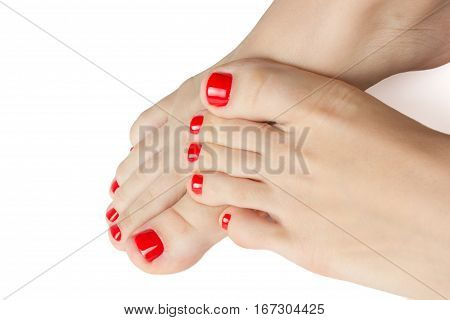Beautiful female feet with a pedicure red color. Isolated on white background