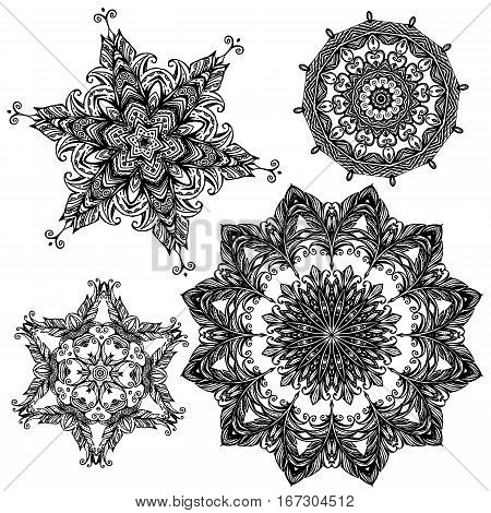 Set of 4 black color round ornaments isolated on white background kaleidoscope floral patterns in indian style. Mandala.