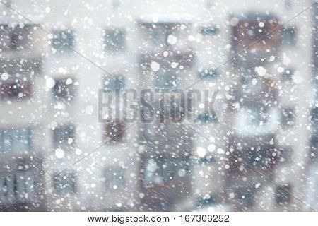 Abstract photo of the snowstorm and residential building on a background