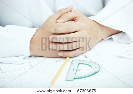 Hands of engineer working with drawing project