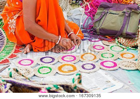 Hand weaving of jute coasters handicrafts on display during the Handicraft Fair in Kolkata. Biggest handicrafts fair in Asia.