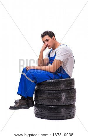 Sad tyre repairman isolated on white