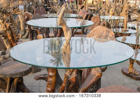 Colorful wooden tables with glass on top handicrafts on display during the Handicraft Fair in Kolkata earlier Calcutta West Bengal India. It is the biggest handicrafts fair in Asia.