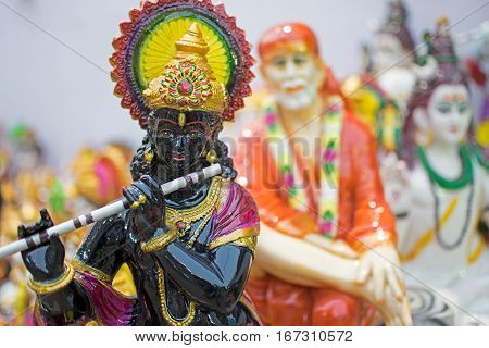 Clay idol of Lord Krishna handicrafts on display during the Handicraft Fair in Kolkata earlier Calcutta West Bengal India. It is the biggest handicrafts fair in Asia.