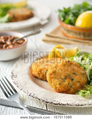 Delicious home made breaded fish cakes with baked beans.
