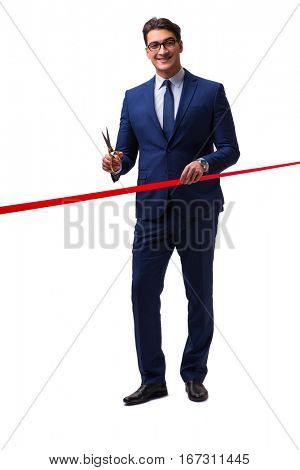 Businessman cutting red ribbon isolated on white