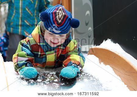 Child Lying On Slide