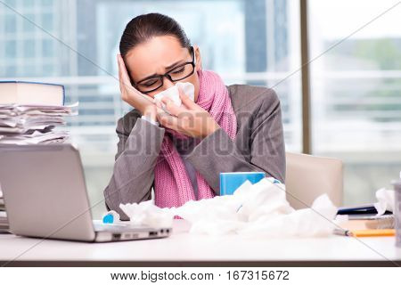 Young businesswoman sick in the office