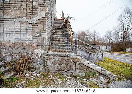 old abandoned building on gloomy cold autumn day