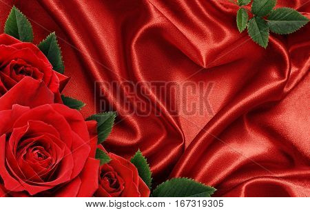 Red satin fabric draped in the form of heart and red rose flowers for Valentine's day background
