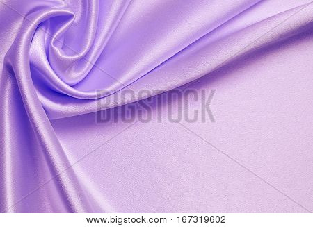 Lilac silk background with drapery in a corner