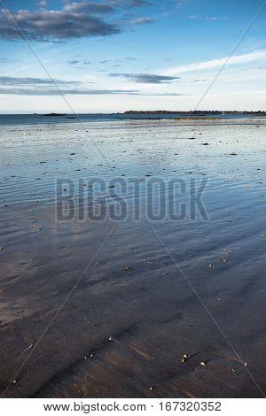 Endless sand shore of Atlantic ocean at low-tide in Saint-Malo, Bretagne France