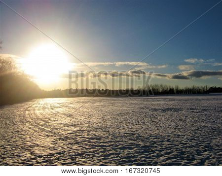 photo with a winter landscape background of the European rural landscape at sunset of sparkling snow icicles as the source for design, printing, advertising, photo shop