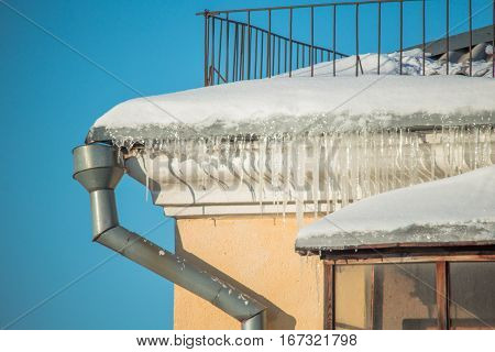 Dangerous Icicles In A House Roof