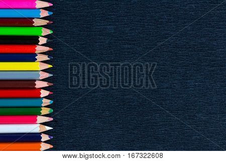 Black Background For Presentations With Vertical Colourful Border Of Pencils