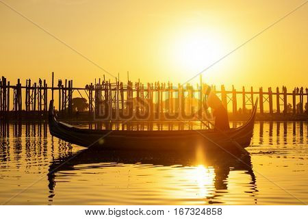 Fishman under U bein bridge at sunset, Myanmar landmark in mandalay