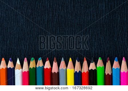 Black Background For Presentation With Colourful Bottom Border Of Pencils