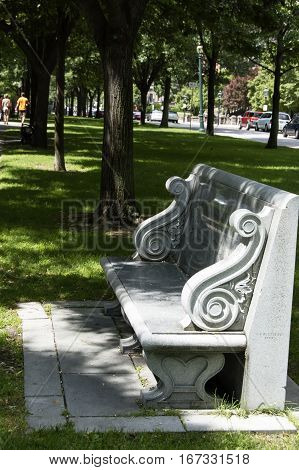 Boston, Massachusetts, US, 27 Jul. 2009: A polished granite bench dedicated to Charles Pagelsen Howard is located on the Commonwealth Avenue Mall in the Back Bay section of Boston.