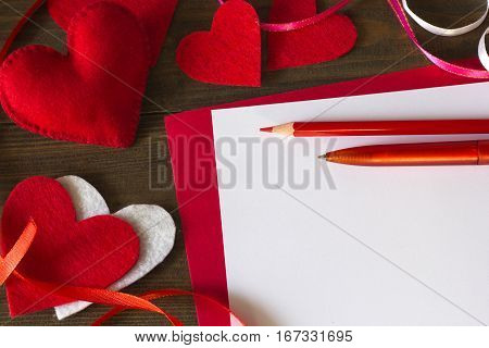 lot of hearts of felt, paper tape, pencil and pen preparation for Valentine's Day