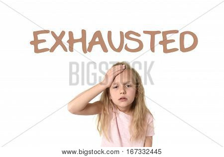 learning English language vocabulary school card with the word exhausted and sweet cute little female child touching her head suffering headache looking tired and sad isolated on white background