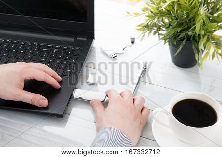 Man plugging GSM modem into a laptop