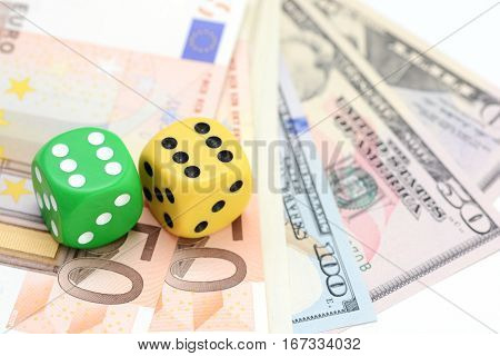Taking a risk and winning concept with a pair of dice standing on money
