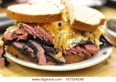 Tasty corned beef pastrami sandwich close up