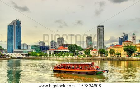 Heritage boat on the Singapore River with the Parliament House in the background