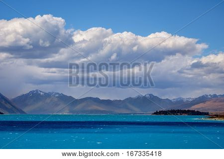 Landscape View Of Lake Tekapo, Mountains And Dramatic Clouds, Nz